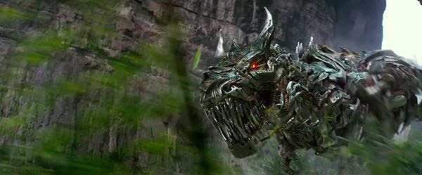 Grimlock charges at Optimus Prime (off-screen) in TRANSFORMERS: AGE OF EXTINCTION.