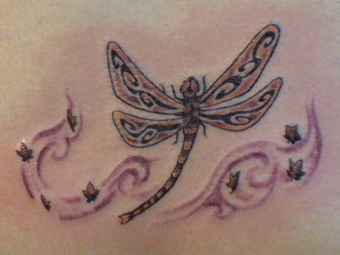 Kind  of a tribal dragonfly tattoo