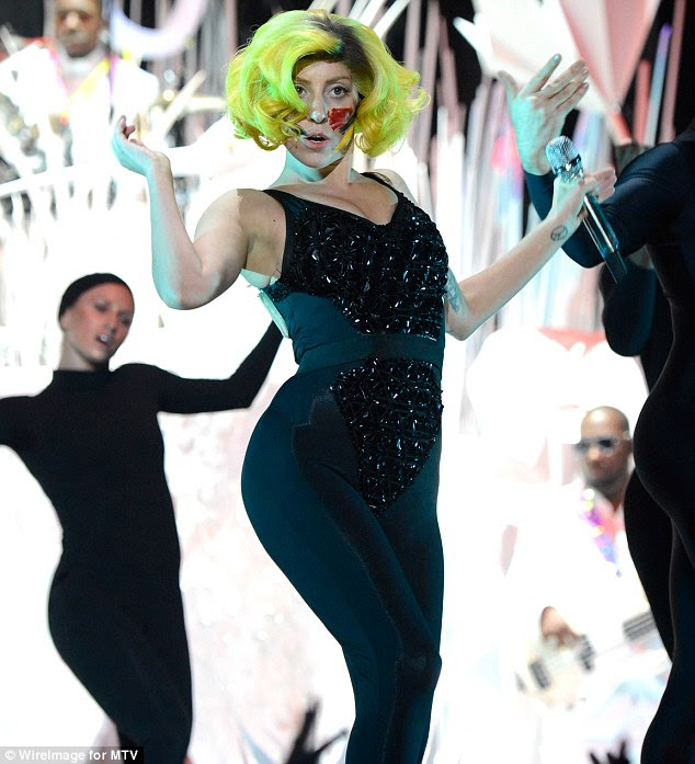 Look No. 4: Lady GaGa donned a yellow-sprayed wig and face paint for one of her many outfit changes