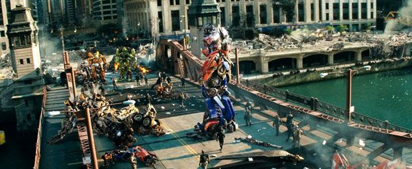 Optimus Prime reunites with his fellow Autobots, Sam Witwicky and the NEST team in TRANSFORMERS: DARK OF THE MOON.