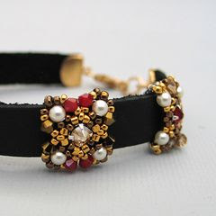 Beaded slider bead on Red-brown leather bracelet