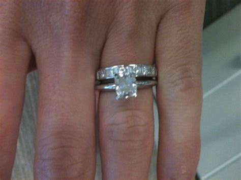 What do solitaire e rings look like with diamond bands?