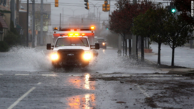 A repair truck drives down a flooded street in Rehoboth Beach, Delaware, on Monday.