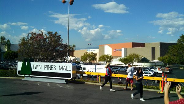 The Twin Pines Mall sign and Doc Brown's van from BACK TO THE FUTURE on display at Puente Hills Mall in the City of Industry...on October 21, 2015.