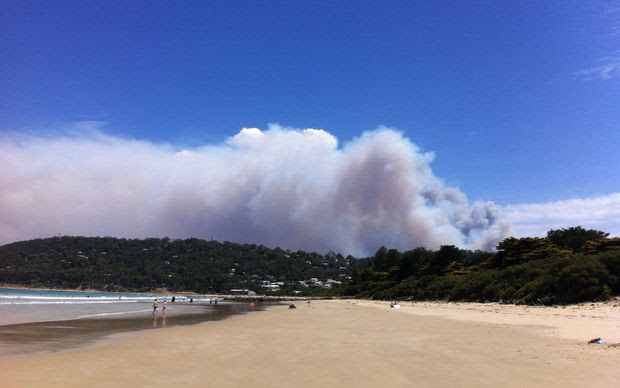 Smoke rises from a fast-moving bushfire near the Great Ocean Road in Victoria.