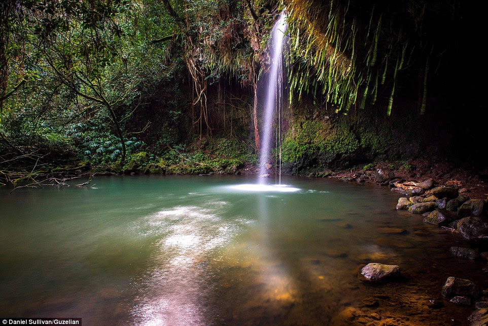 An oasis-like scene at the Twin Falls in Maui alongside the disappearing King's Highway that Sullivan is aiming to immortalise
