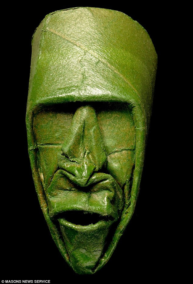 Bog standard: The gurning, grinning, mischievous mask - made entirely from a loo roll - are the creation of French artist Junior Fritz Jacquet
