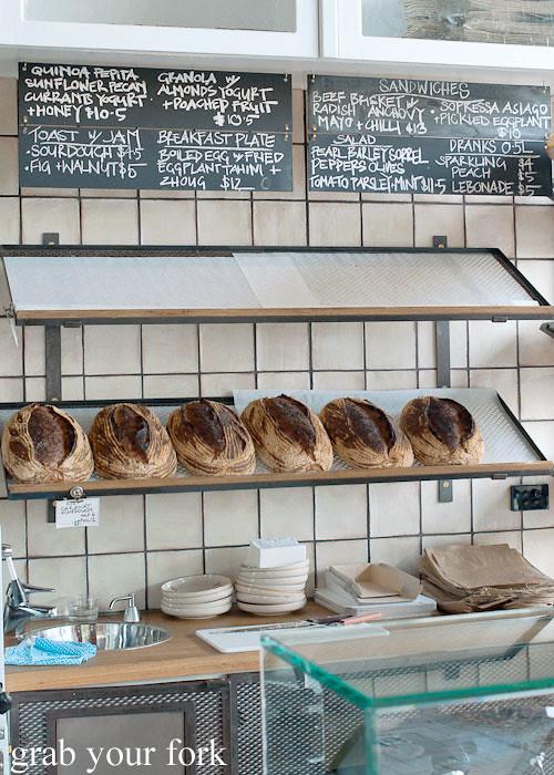 sourdough bread and blackboard menu at brickfields chippendale