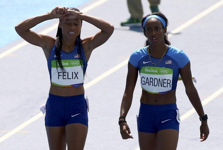 2016 Rio Olympics - Athletics - Preliminary - Women's 4 x 100m Relay Round 1 - Olympic Stadium - Rio de Janeiro, Brazil - 18/08/2016. Allyson Felix (USA) and English Gardner (USA) of USA react   REUTERS/David Gray
