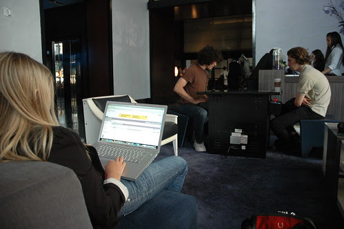 Laptop user, two young men playing a digital game, W Hotel, San Francisco, California, USA