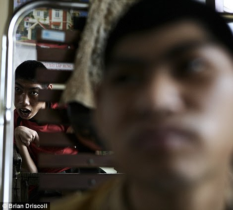 Nguyen, and Hung Vuong Pham, 14, and 15, await their daily routine of eating and bathing