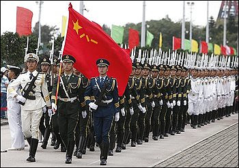 Chinese People's Liberation Army (PLA) personnel parade during the open day of Stonecutter Island Navy Base in Hong Kong Saturday, March 6, 2010. by Pan-African News Wire File Photos