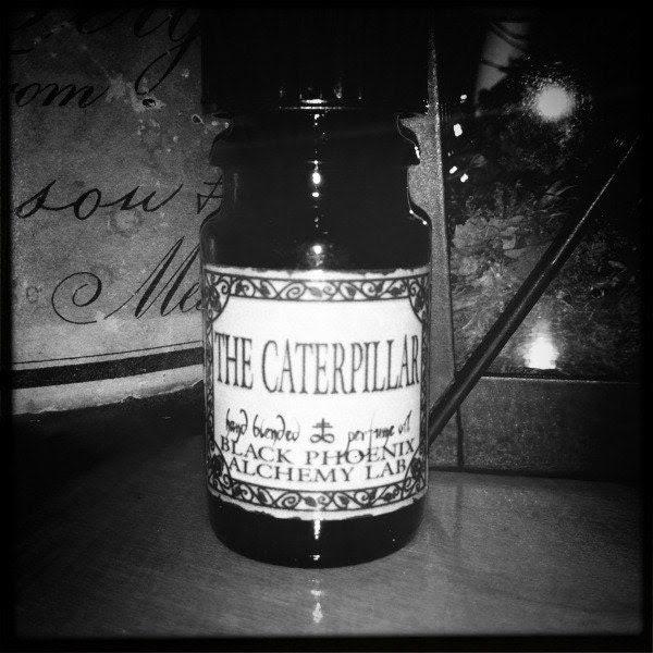 The Caterpillar: Black Phoenix Alchemy Lab Alice in Wonderland Perfume Oil