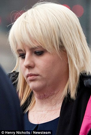 Miss Horsman is pictured arriving at court today, where the scars on her neck could be seen