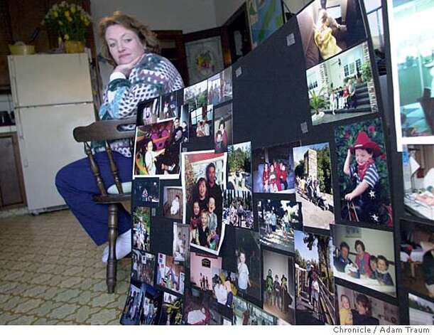 Maureen Fabish, mother of Nicholas Faibish who was killed says that her dogs were great family dogs and slept with her children regularly. Here, Fabish looks at poster boards filled with images of Nicholas that were at his funeral. Chronicle Photo/Adam Traum Photo: Adam Traum