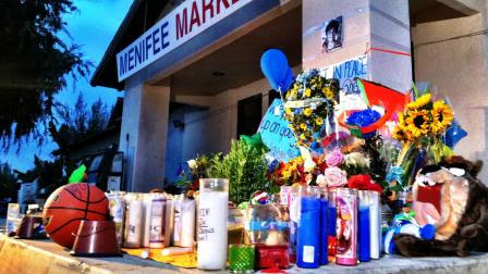 Candles, flowers, toys and messages of love are seen at a makeshift memorial for 11-year-old Terry Smith on Thursday, July 11, 2013.