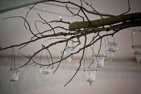 Textured wedding reception decor  manzanita branches hung