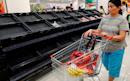 Empty supermarket shelves as Hong Kong shops close their doors amid protests