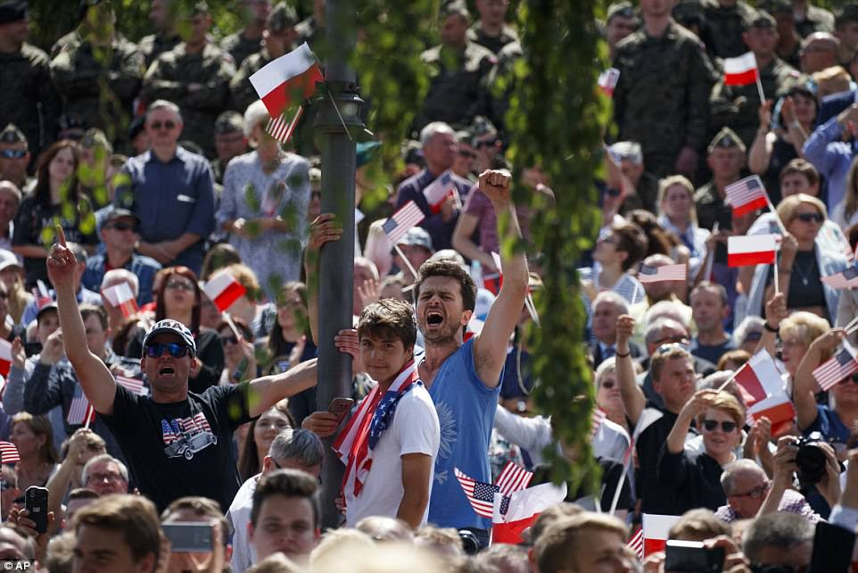 People cheer as Trump delivers his landmark speech at Krasinski Square at the Royal Castle on Thursday morning