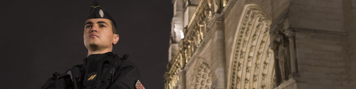 A French gendarme enforcing the Vigipirate plan, France's national security alert system, is pictured on November 19, 2015 in front of the Notre-Dame cathedral in Paris. France revealed on November 19 it will spend an extra 600 million euros (USD 641 million) next year to ramp up security after the Paris attacks. President Francois Hollande announced this week that France is freezing plans to cut troop numbers through 2019. At the same time, the country will add 8,500 law enforcement jobs including 5,000 new police. AFP PHOTO / JOEL SAGET (Photo credit should read JOEL SAGET/AFP/Getty Images)