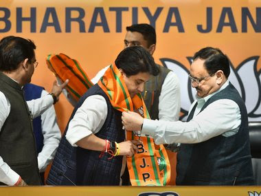 Jyotiraditya Scindia (C) being felicitated by BJP National President JP Nadda (R) after joining BJP. PTI