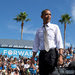 President Obama kept up attacks on Mitt Romney in Delray Beach, Fla., on Tuesday, a drive that Mr. Romney called desperate.