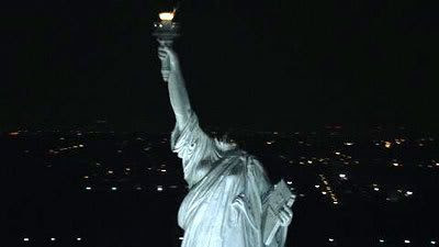 The Statue of Liberty lies headless in the cold New York night.