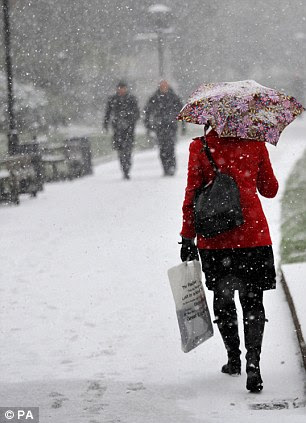 A commuter makes her way though London's Embankment Gardens today