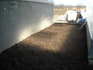 Landscaping Mulch Between Cistern and Summer Kitchen