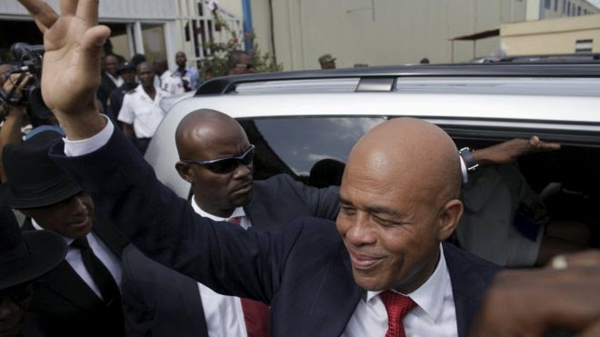 Martelly says goodbye after a ceremony marking the end of his presidential term, at the Haitian Parliament in Port-au-Prince, Haiti
