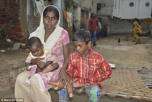 His motherHaleema, 27, (pictured with Kaleem and another one of her children) said she feels 'powerless'