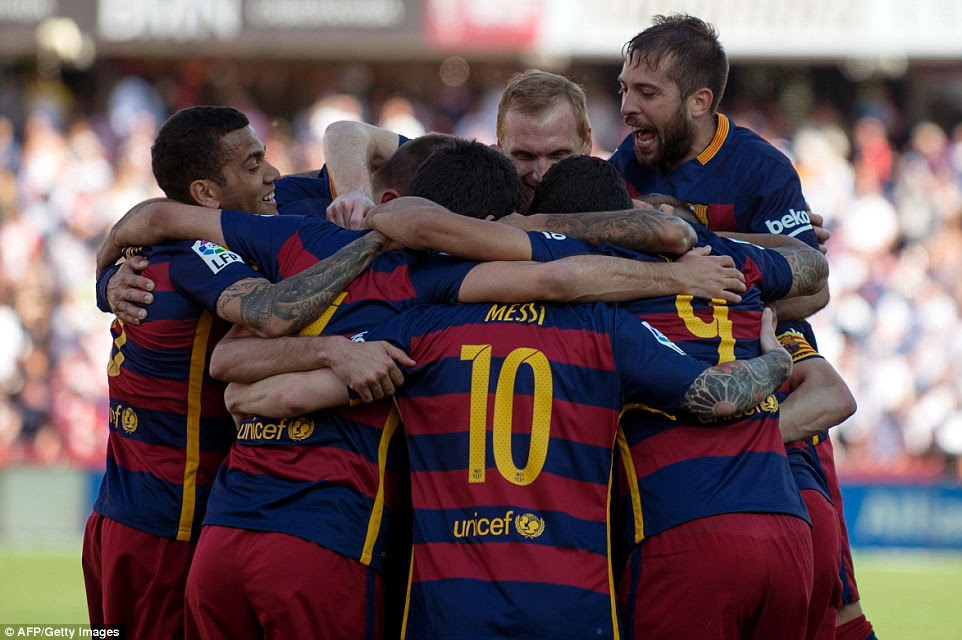 Barcelona players celebrate at the final whistle after their 3-0 win over Granada on Saturday secured another La Liga crown