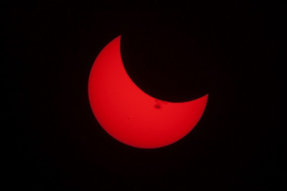 The partial solar eclipse of October 23, 2014, with a giant sunspot visible. Credit and copyright: Derek Mellott.