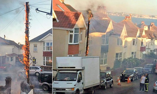 Shocking moment wooden telephone pole in Devon burst into flames