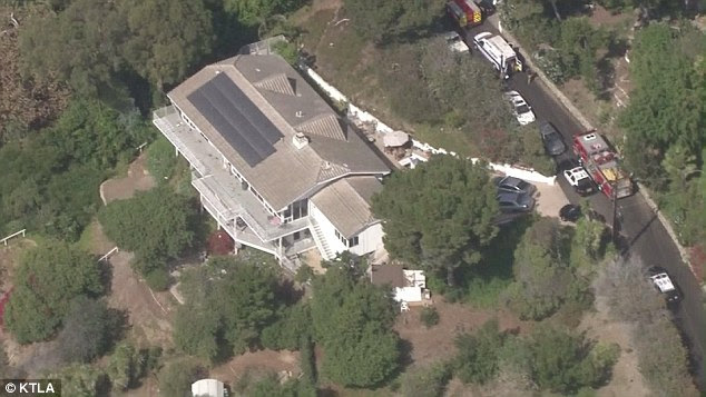 Fire fighters and police descended on the property in north Malibu on October 14