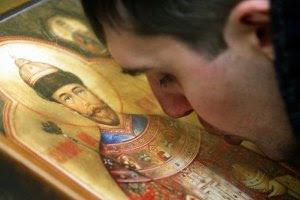 Russian Orthodox faithful kisses the icon of St. Nicholas