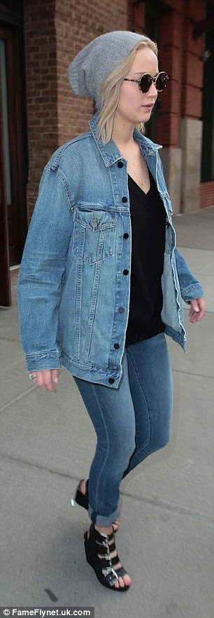 She's got this:Jennifer stepped out in an Alexander Wang ensemble which featured a pair of light denim slim fit jeans - which she rolled at the ankles - with a classic V-neck tee under the label's Daze oversized jacket