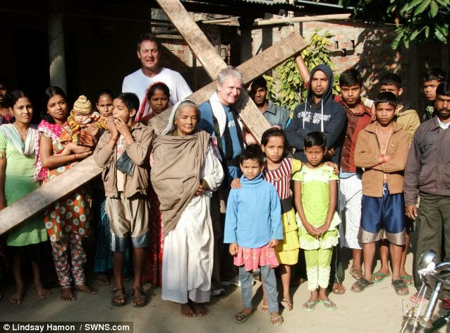 Journey: Mr Hamon poses with his cross in Assam. He first took up the 12ft 6in tall cross in 1987 and has spent only a handful of days without it
