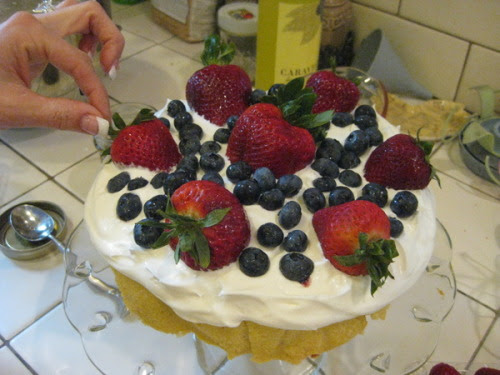 My first adventure in the kitchen this summer took place on mother's day!  It was something wonderful, brace yourself, Lemmon Pound Cake w/ Limoncello Cream and Fresh Berries, be jealous!  My family also ate it in one setting, I do not recommend that but it is so good you might do the same thing. Ingredients 2 cups sugar 1/2 cup shortening 1/2 cup butter, softened 4 tsp lemon zest 5 large eggs 2 cups all-purpose flour 1/4 tsp salt 1/2 cup milk 1 tsp vanilla extract 1 recipe Limoncello Cream (recipe follows) Fresh blueberries Fresh strawberries Fresh blackberries (we didn't have but will have next time) Garnish: lemon zest Preheat oven to 300 degrees F. Spray a 10 inch round cake pan with nonstick cooking spray; line with parchment paper. In a large bowl, combine sugar , shortening, butter, and lemon zest, beat at medium speed with an electric mixer until creamy. Add eggs, one at a time beating well after each addition. In a small bowl, sift together flour and salt. Gradually add flour mixture to butter mixture, alternately with milk beating to mix well. Beat in vanilla. Spoon batter into prepared pan . Bake for 50 to 60 minutes, or until a wooden pick inserted in center comes out clean. Cool in pan for 10 minutes. Remove to wire rack, and cool completely. Spread Limoncello cream on top of cake. Top with fresh berries. Garnish with lemon zest, if desired. Limoncello Cream (makes 4 cups) 2 cups heavy whipping cream 1/2 cup confectioners' sugar 1/4 cup Limoncello in a medium bowl, beat cream at high speed with an electric mixer until soft peaks form. Gradually add sugar beating until stiff peaks form. Beat in Limoncello. Cover, and chill until ready to serve. This makes alot of cream, we had more left over than we could top the cake with.  So….I took a spoon and ate the remaining.