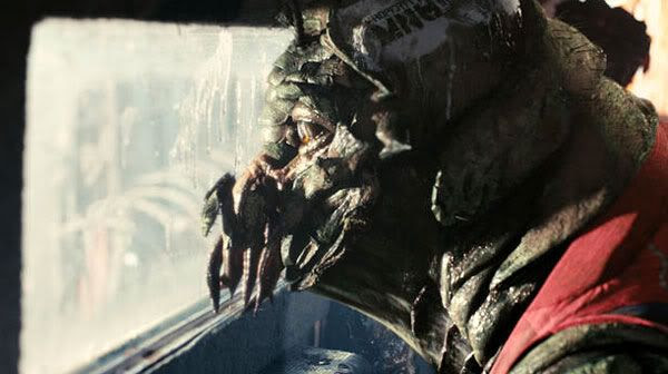 Christopher Johnson, a prawn held captive inside an MNU armored truck, gazes out the window to see what's going on in DISTRICT 9.
