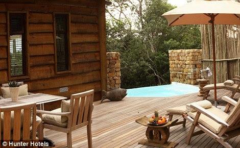 accessed by wooden walkways, features floor-to-ceiling bedroom windows