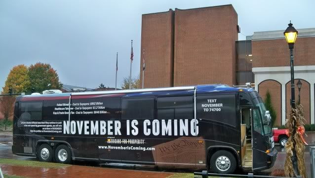 The November is Coming bus outside the Macon County Courthouse