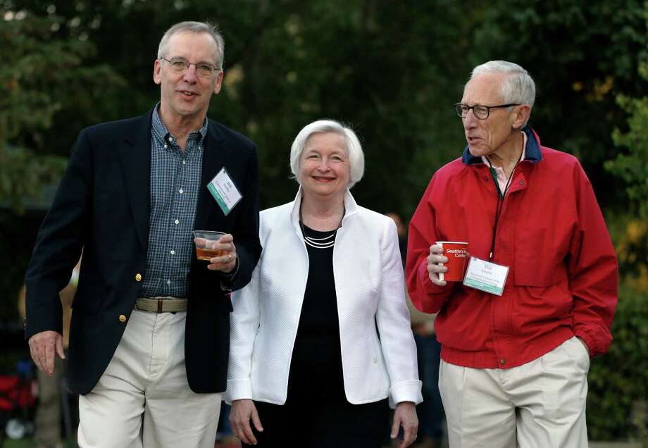 Federal Reserve Chair Janet Yellen, center, strolls with Stanley Fischer, right, vice chairman of the Board of Governors of the Federal Reserve System, and Bill Dudley, the president of the Federal Reserve Bank of New York, before her speech to the annual invitation-only conference of central bankers from around the world, at Jackson Lake Lodge in Grand Teton National Park, north of Jackson Hole, Wyo., Friday, Aug 26, 2016. (AP Photo/Brennan Linsley) Photo: Brennan Linsley, STF / Copyright 2016 The Associated Press. All rights reserved. This material may not be published, broadcast, rewritten or redistribu