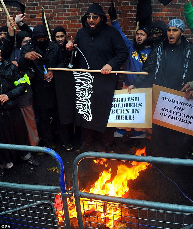 Protesters burning a poppy at a Muslims against Remembrance Day protest on November 11 last year