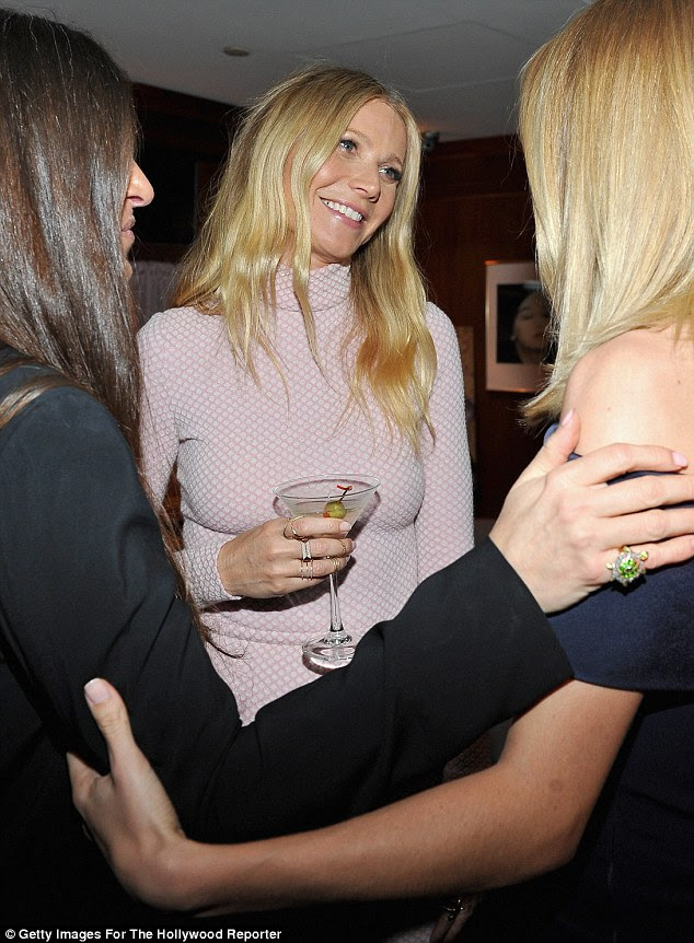 Cheers!: Gwyneth looked like she was having a great time, and sipped on a martini