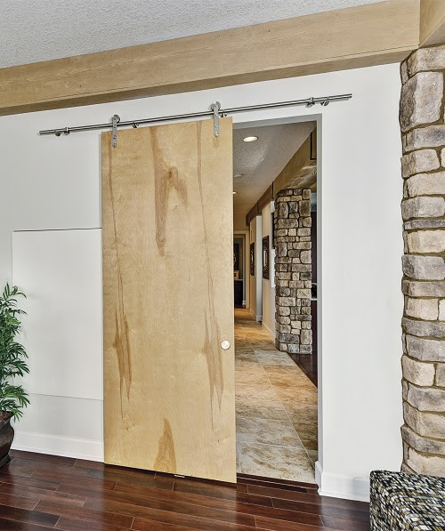 Wall Mounted Doors for an Industrial Look | Dig This Design