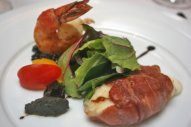 Antipasti - Pan-fried Buffalo Mozzarella wrapped in Parma Ham served with black Olives Tapenade