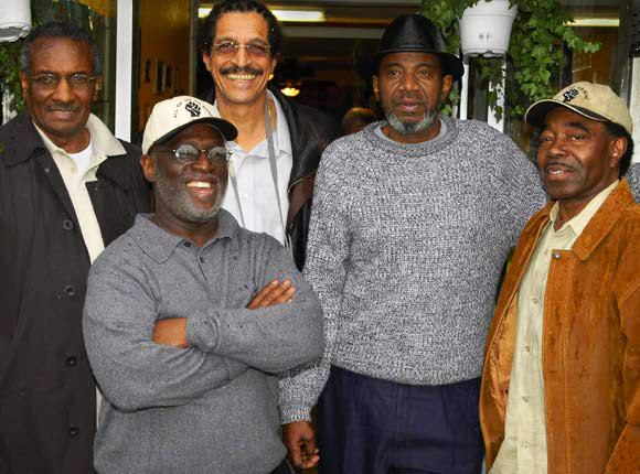 """John Bowman, backed here by Hank Jones, Ray Boudreaux, Harold Taylor and Richard Brown of the SF 8, would have been arrested with them if he hadn't died the month before. One of the three who were tortured by New Orleans police in 1973 at the behest of San Francisco police, he said in the film, """"Legacy of Torture"""": """"The same people who tried to kill me in 1973 are the same people who are here today, trying to destroy me. I mean it literally. I mean there were people from the forces of the San Francisco Police Department who participated in harassment, torture and my interrogation in 1973 ... None of these people have ever been brought to trial. None of these people have ever been charged with anything. None of these people have ever been questioned about that."""" – Photo: Scott Braley"""