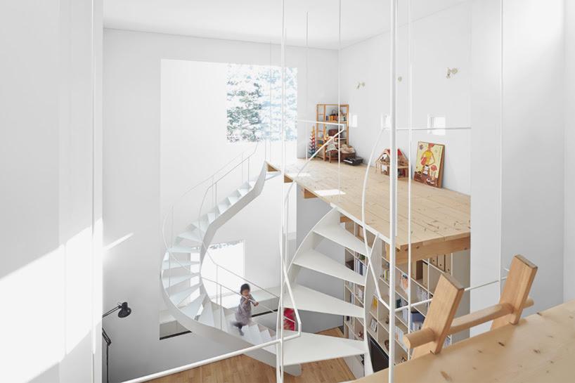 jun igarashi articulates case house around dual staircases