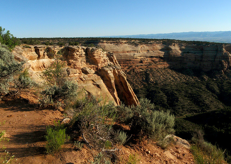Sunrise brings a smile to the faces of stone comprising Colorado National Monument.